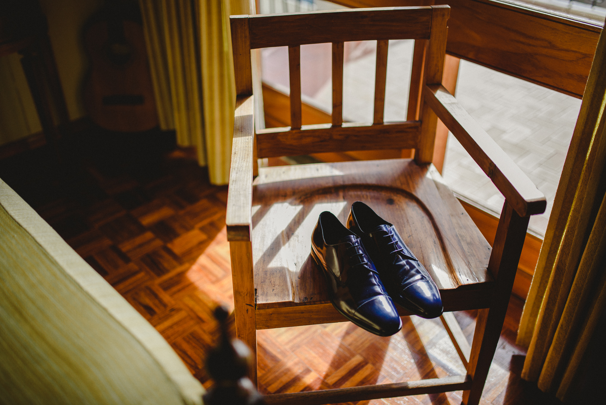 Groom's shoes on a chair while he gets ready.