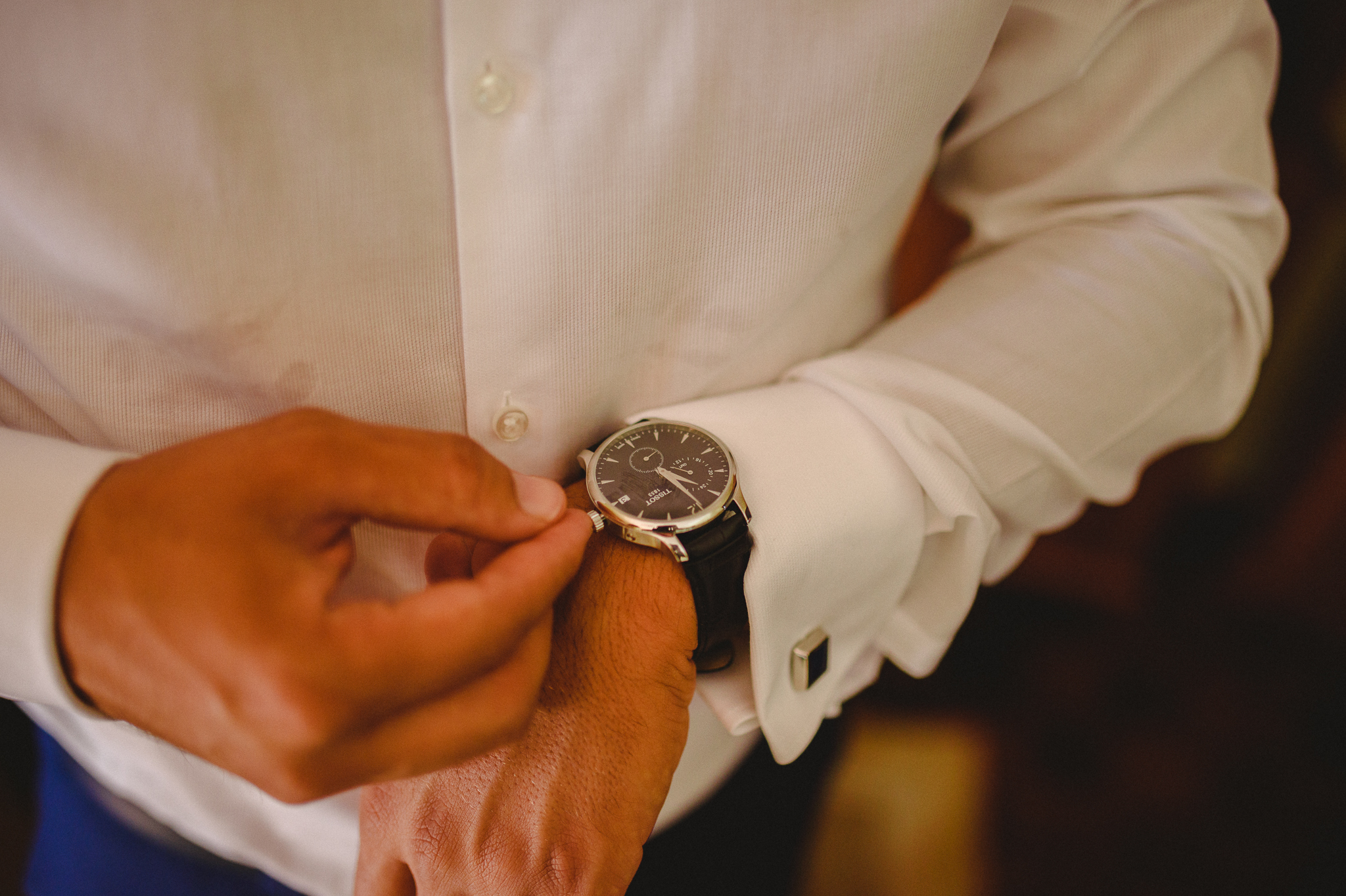 Groom putting on his new watch.