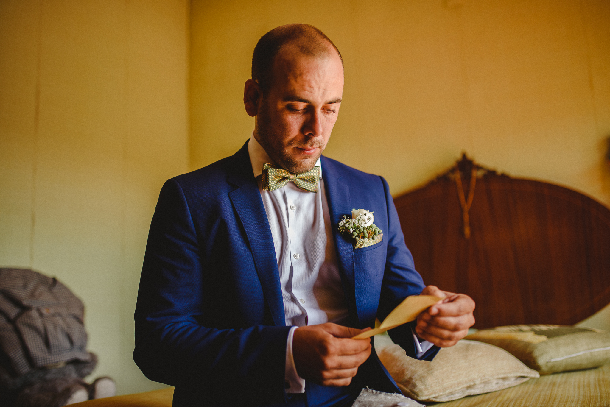 Groom reading a bride's letter