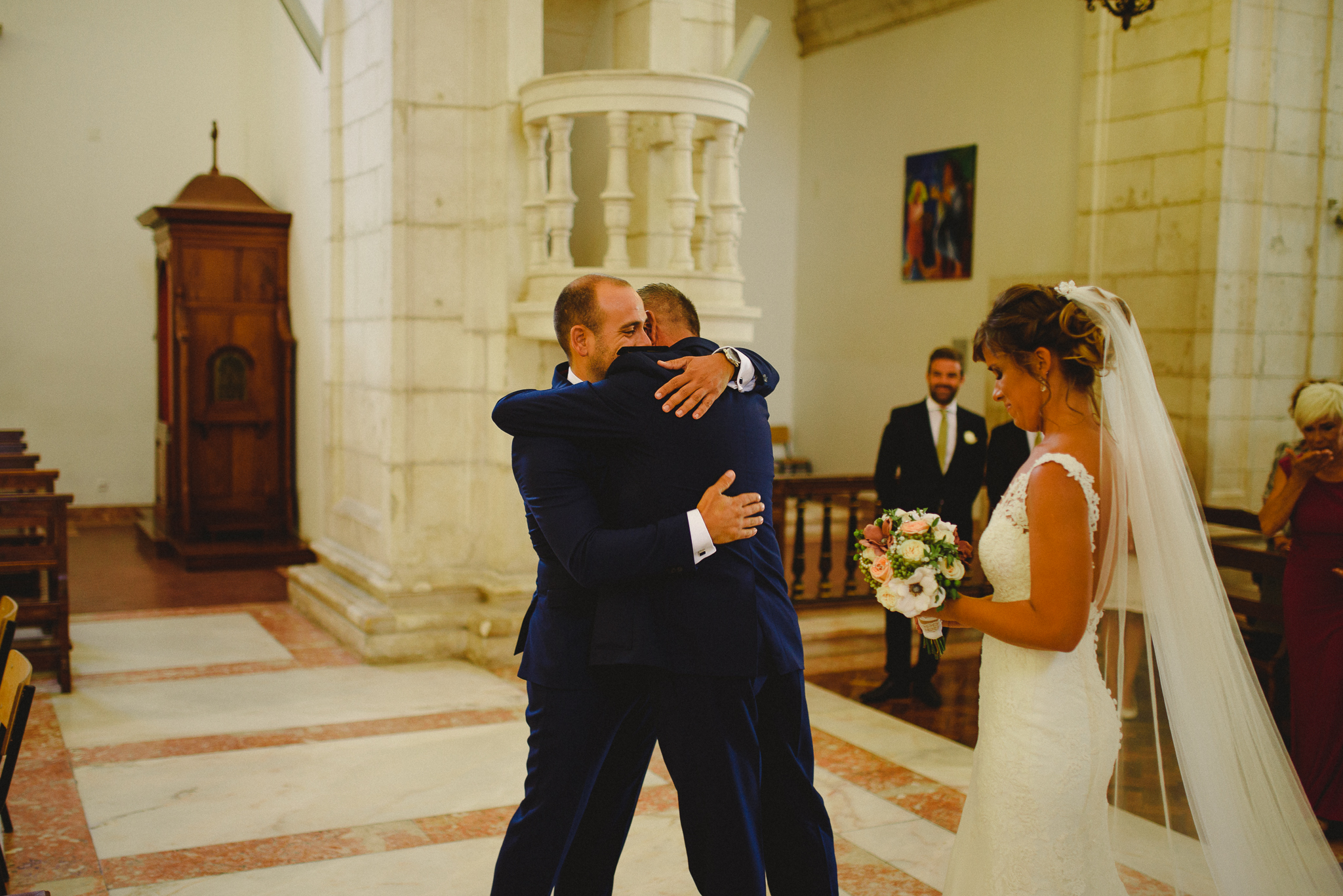 Father of the bride hugging groom after arriving with bride