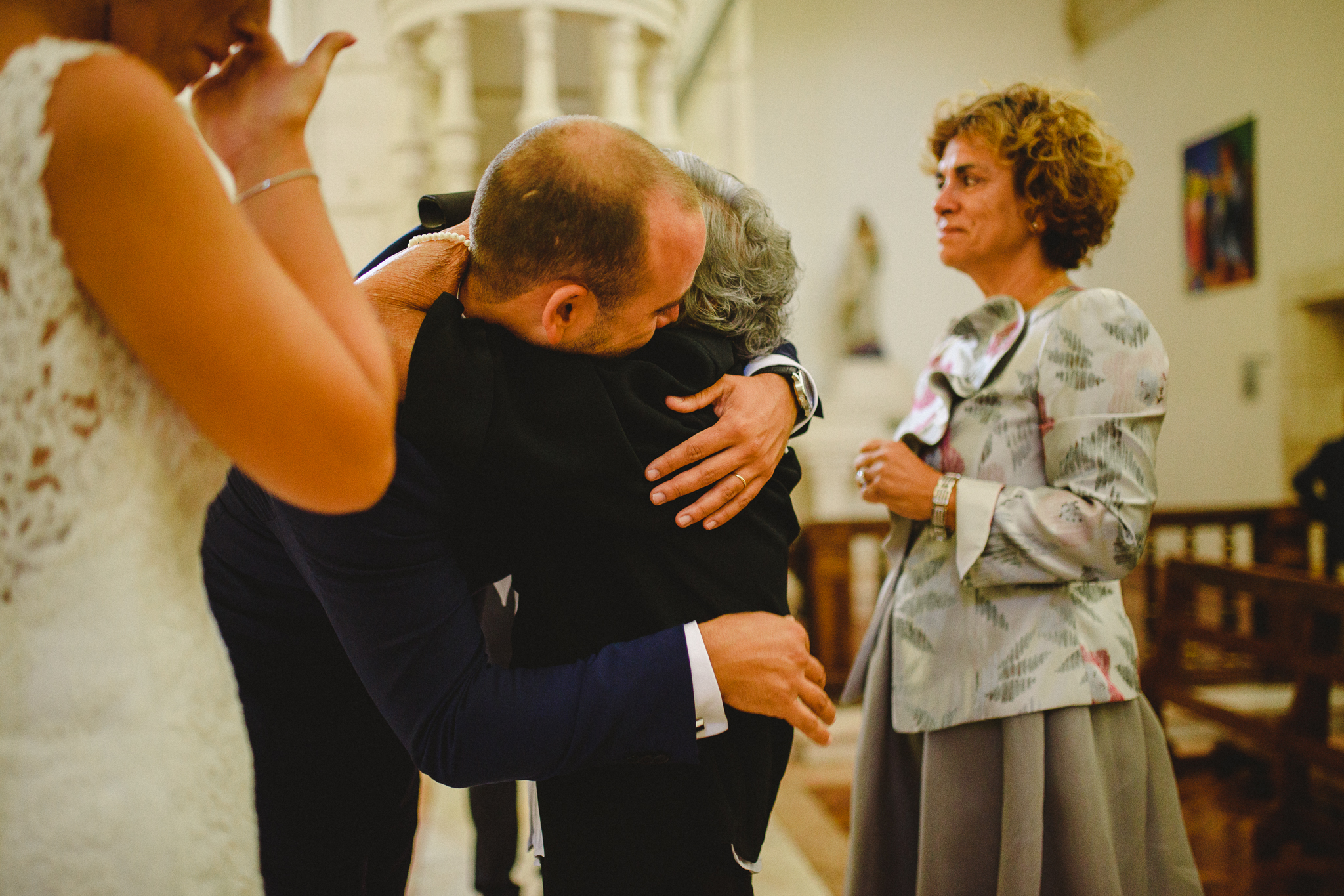Groom hugging his grandmother during ceremony