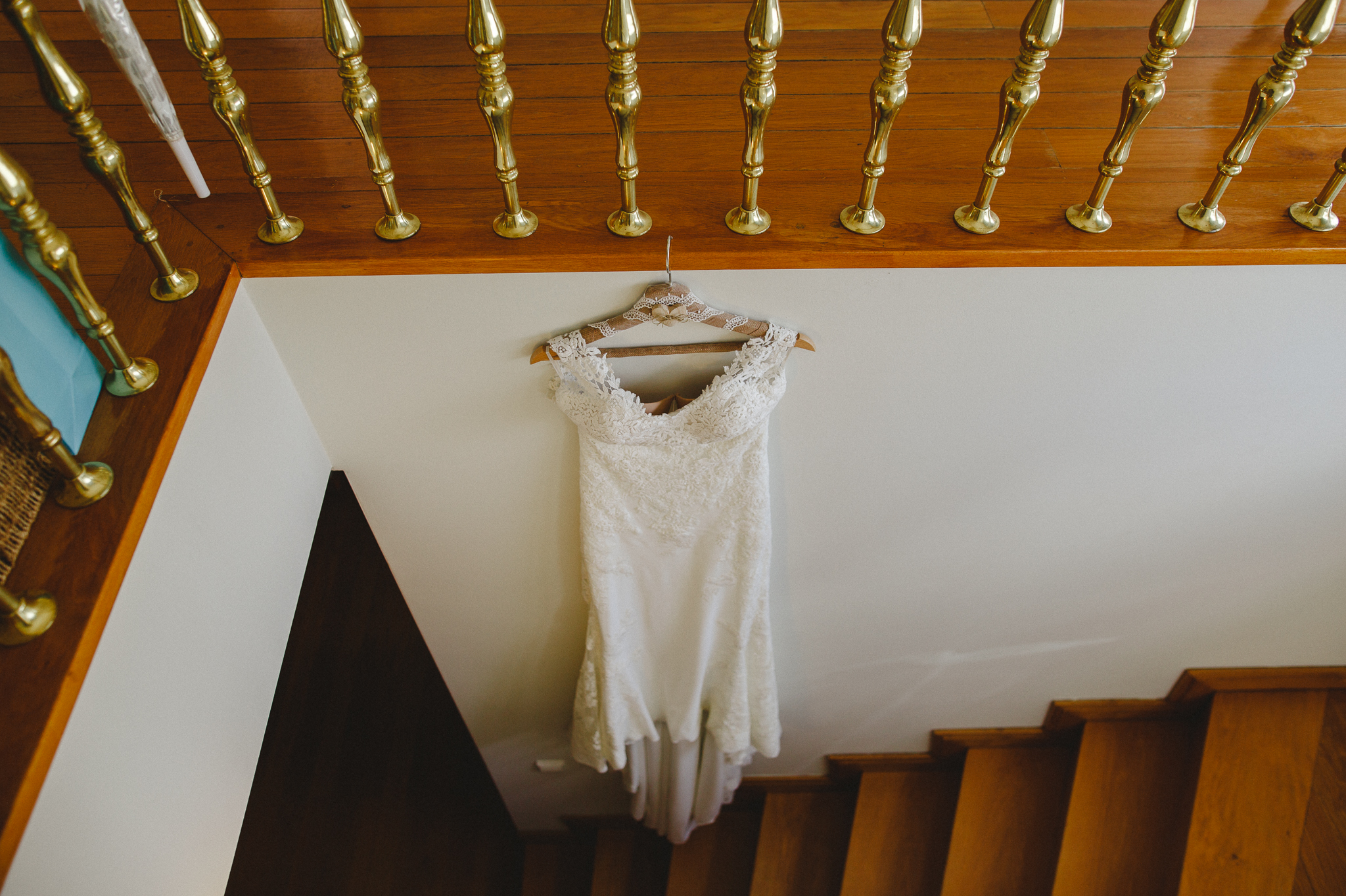 Bride's wedding dress hanging on the stairs