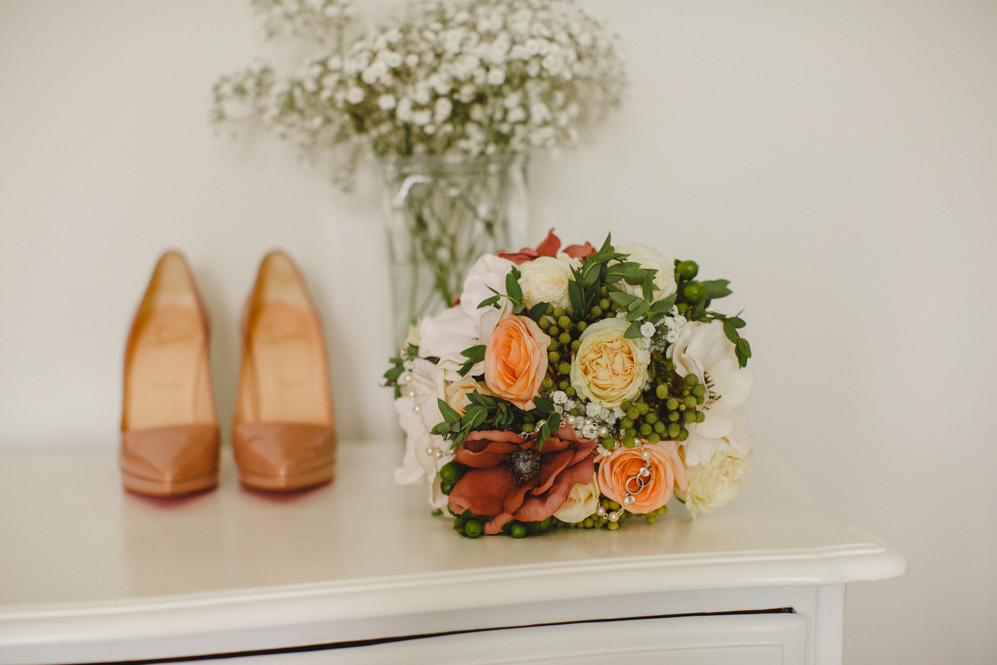 Bride's shoes and flowers.