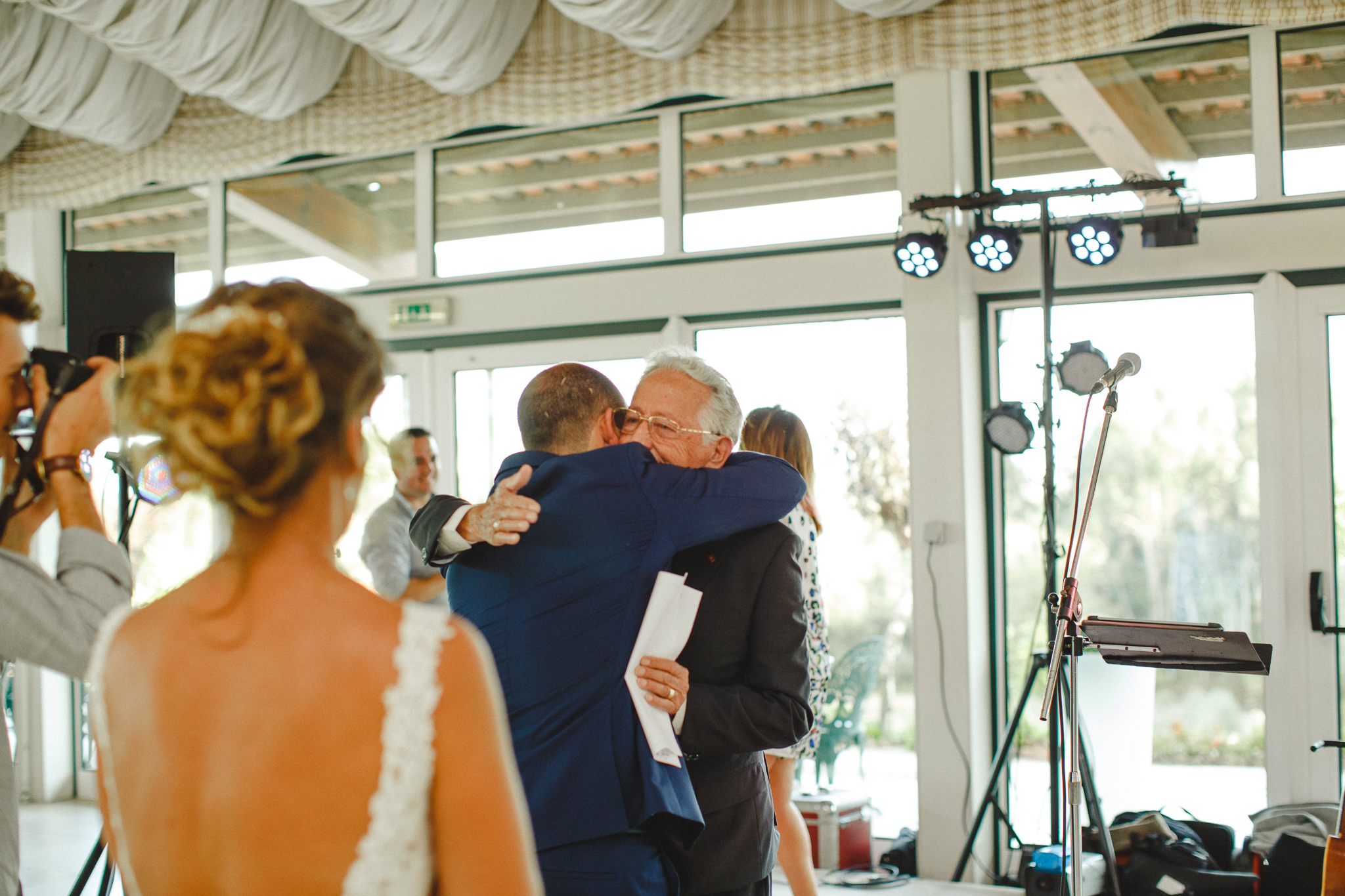 Groom hugging his grandfather after his speech.