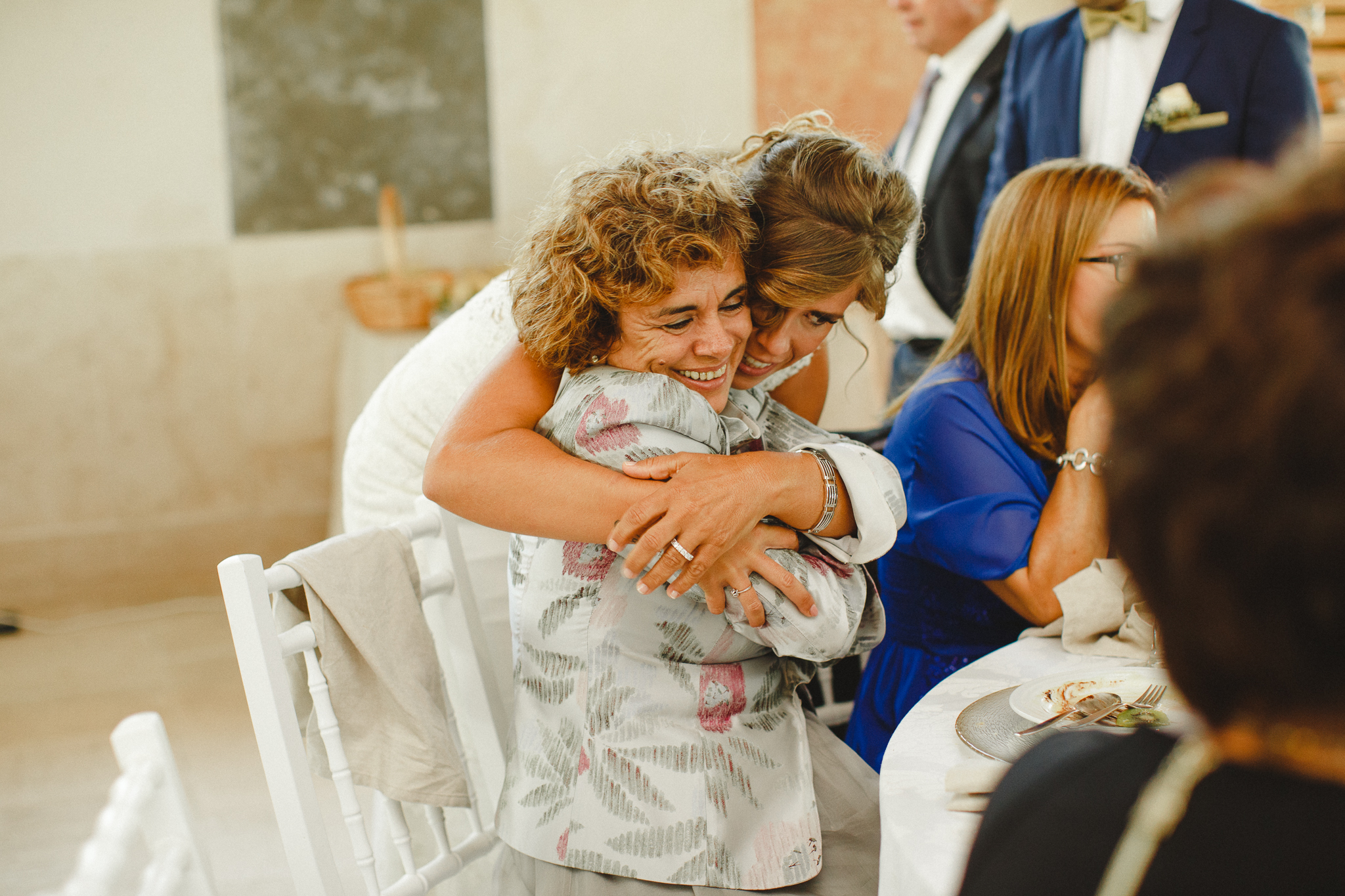 Bride hugging her mother-in-law before lunch.
