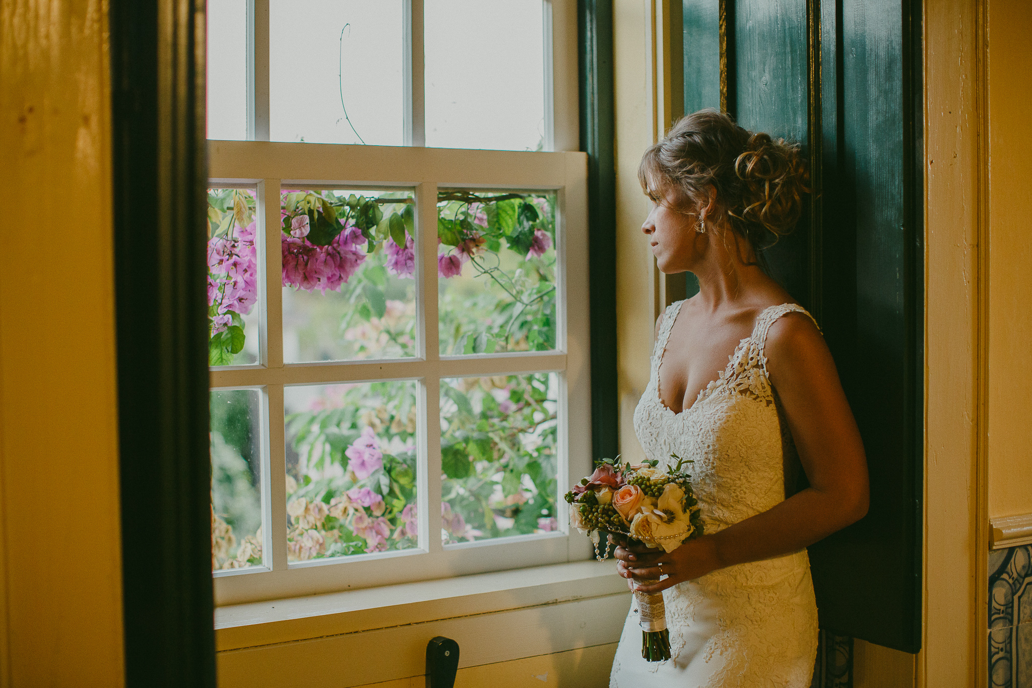 Bride at the window looking outside