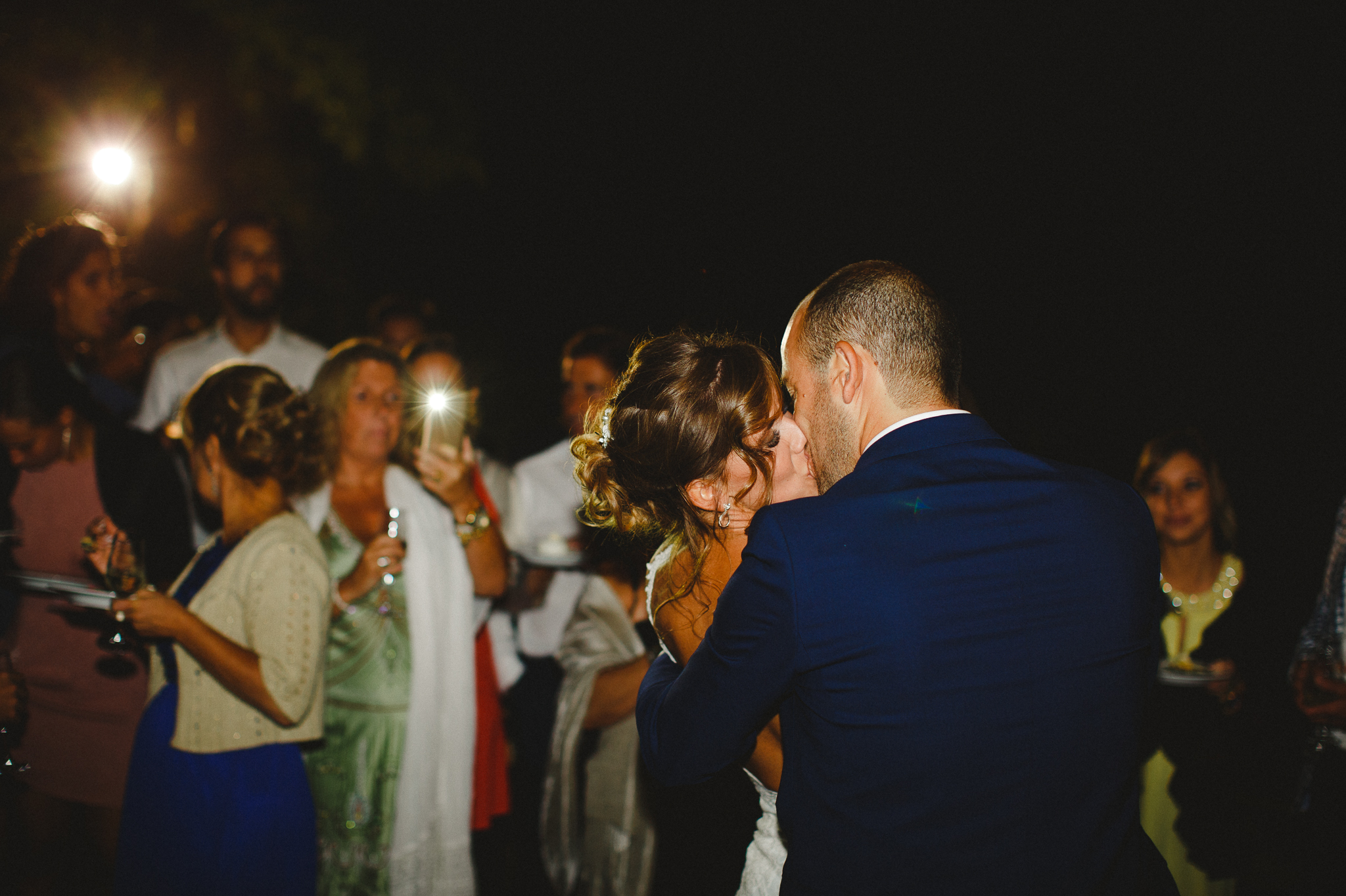 Bride and groom kissing after making a toast