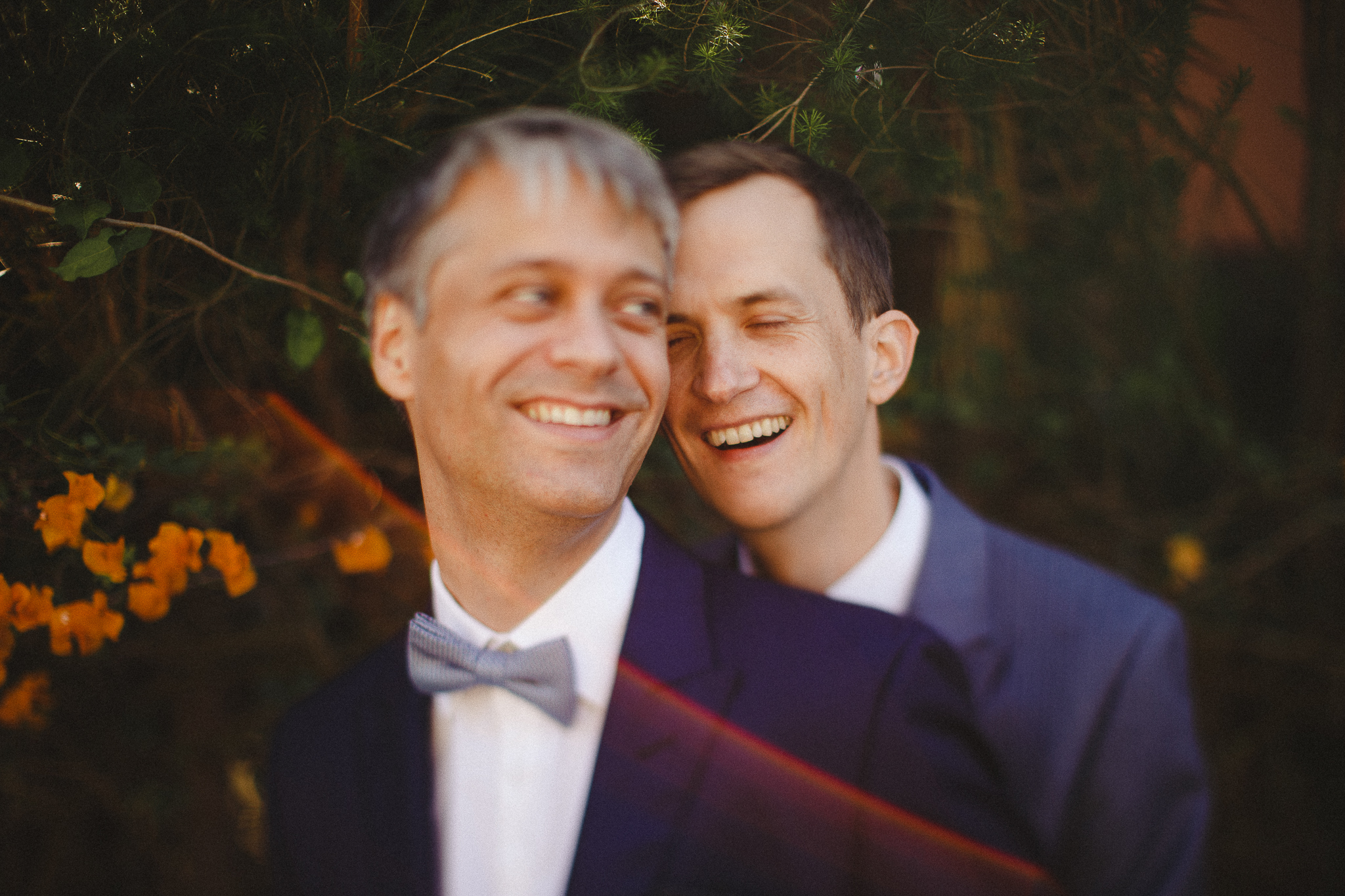 A gay couple smiles during their photo shoot after their elopement in Lisbon.