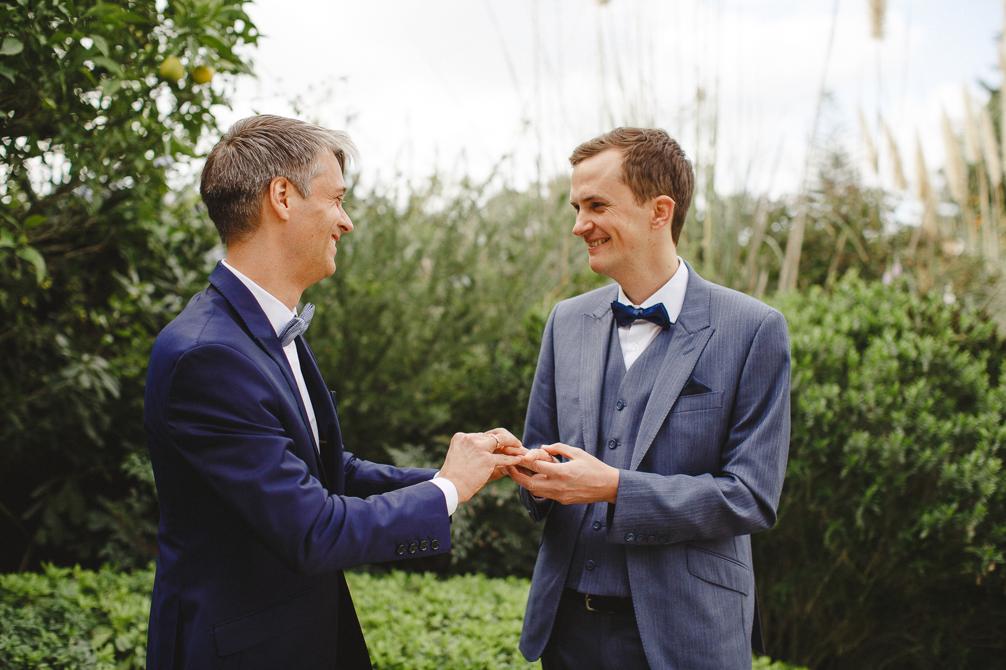 The sweet couple smiles after they exchange rings during their elopement ceremony