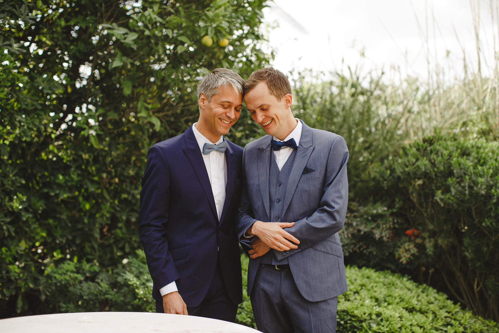 A couple smiles during their elopement ceremony in the Norwegian Embassy in Lisbon