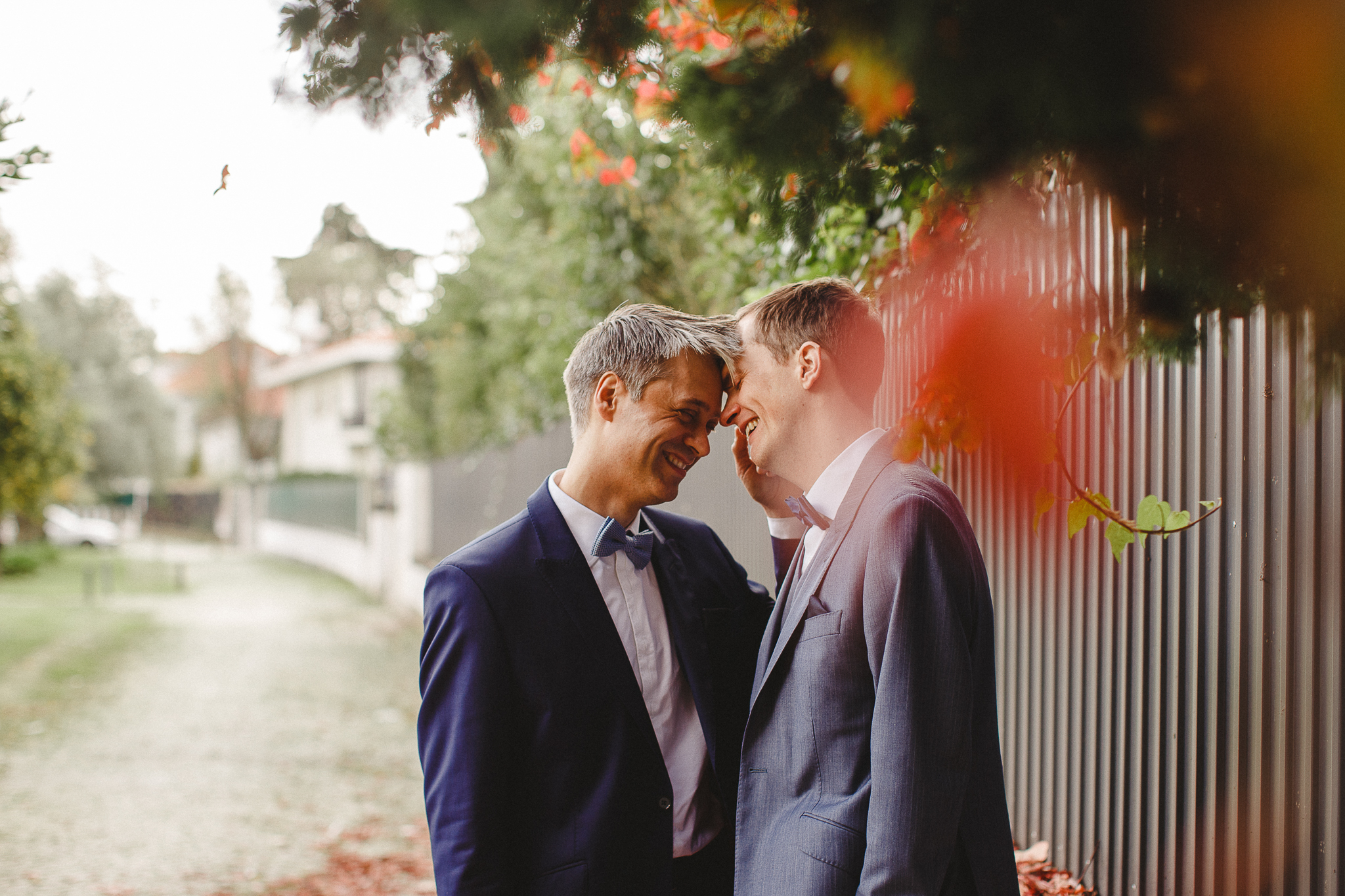 A gay couple smiles during their photo shoot after their elopement in the Norwegian Embassy.