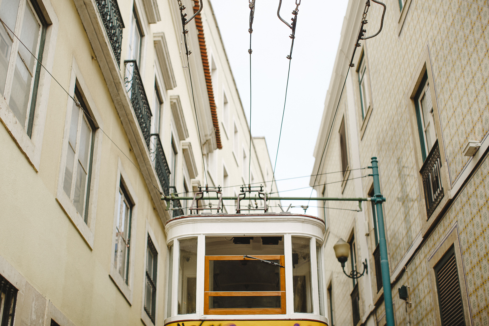 Lisbon's yellow tram in one iconic street.