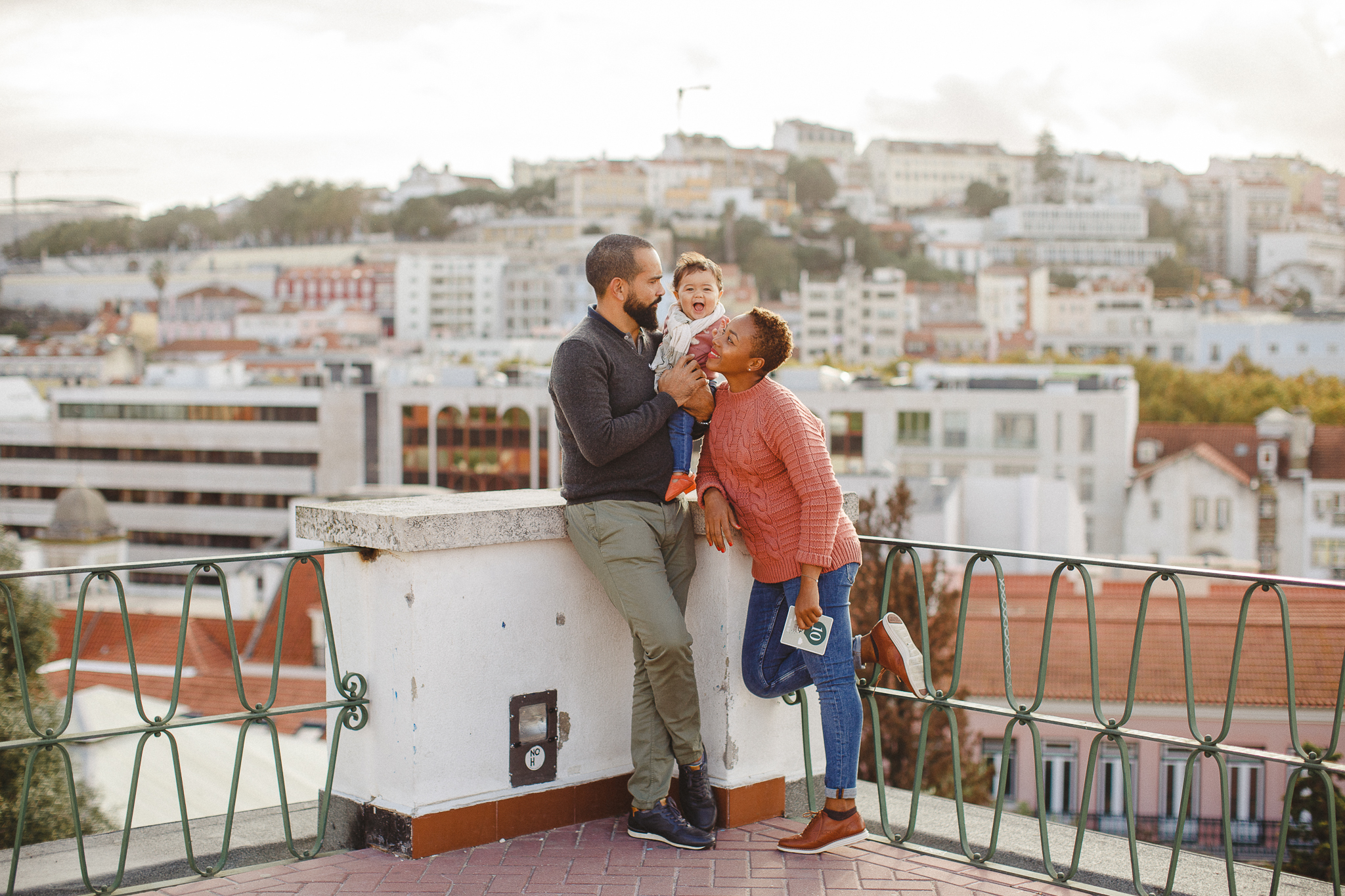 Family smiling during their family photo shoot in Lisbon with Hello Twiggs.