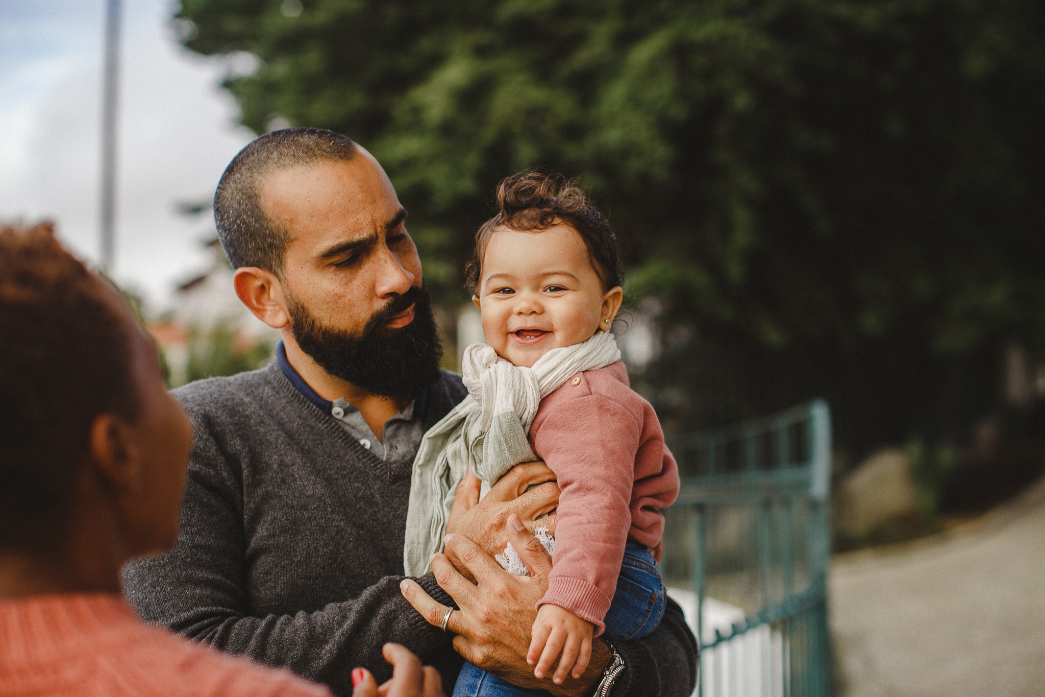 Baby smiling during a family photoshoot in Lisbon.
