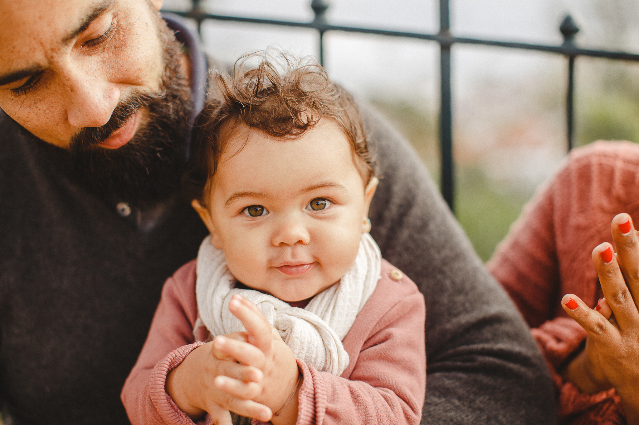 Baby smiling at the camera during a family photo shoot in Lisbon, by Hello Twiggs.